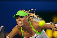 MELBOURNE, 28 JANUARY - Maria Sharapova (RUS) in action against Victoria Azarenka (BLR) during the women's finals match on day thirteen of the 2012 Australian Open at Melbourne Park, Australia. (Photo Sydney Low / syd-low.com)