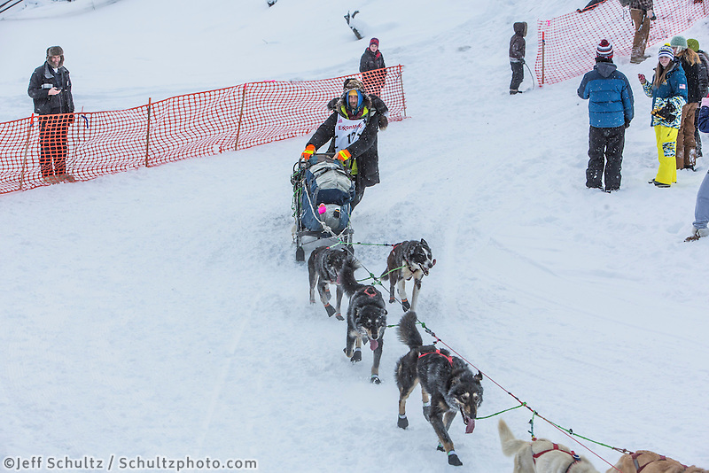 Nicolas Petit from Girdwood, Alaska drops down onto the Chena River with his  team shortly after the start of the 2015 Iditarod sled dog race.Nicolas in Fairbanks. Photo by Todd Paris/IditarodPhotos.com 2015