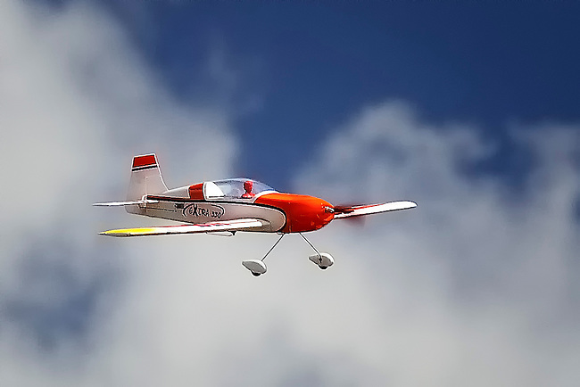 Model airplane fling in the clouds