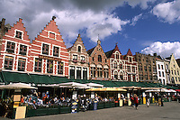 Belgium Market Place in center with  old buildings and cafes in the colorful city of Bruges
