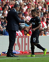 (L-R) Swansea manager Paul Clement greets Wayne Routledge of Swansea City as he comes off the pitch during the Premier League match between Southampton and Swansea City at the St Mary's Stadium, Southampton, England, UK. Saturday 12 August 2017