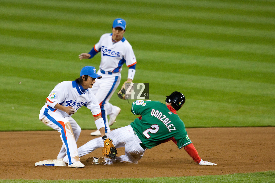 15 March 2009: #2 Edgar Gonzalez slides as #8 Keunwoo Jeong of Korea tags him during the 2009 World Baseball Classic Pool 1 game 2 at Petco Park in San Diego, California, USA. Korea wins 8-2 over Mexico.