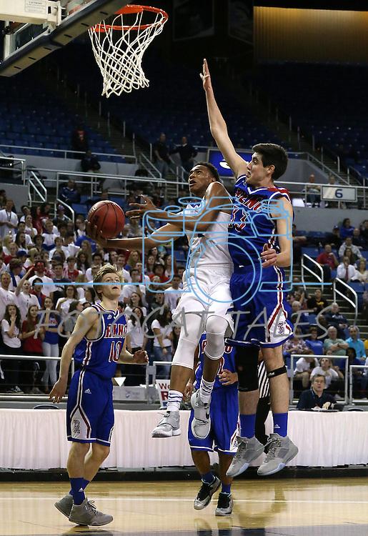 Bishop Gorman's Chuck O'Bannon past Reno defender Michael Heydon during the NIAA Division I state basketball tournament in Reno, Nev. on Thursday, Feb. 25, 2016. Gorman won 70-39. Cathleen Allison/Las Vegas Review-Journal
