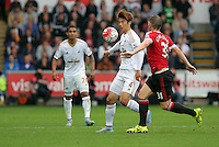 Pictured: Ki Sung Yueng of Swansea marked by Morgan Schneiderlin of Manchester United Sunday 30 August 2015<br /> Re: Premier League, Swansea v Manchester United at the Liberty Stadium, Swansea, UK