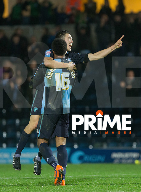 Luke O'Nien of Wycombe Wanderers celebrates with goal scorer Aaron Holloway of Wycombe Wanderers during the Sky Bet League 2 match between Wycombe Wanderers and Notts County at Adams Park, High Wycombe, England on 15 December 2015. Photo by Andy Rowland.