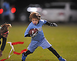 The Panthers' Jack Dye vs. The Eagles in Oxford Park Commission flag football, at FNC Park in Oxford, Miss. on Tuesday, November 19, 2013.