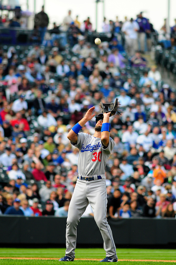 14 September 08: Los Angeles Dodgers 3rd baseman Casey Blake makes a catchin the infield during a game against the Colorado Rockies. The Colorado Rockies defeated the Dodgers 1-0 in 10 innings at Coors Field in Denver, Colorado. FOR EDITORIAL USE ONLY