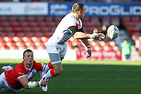 PICTURE BY ALEX WHITEHEAD/SWPIX.COM - Rugby League - Autumn International Series - Wales vs England - Glyndwr University Racecourse Stadium, Wrexham, Wales - 27/10/12 - England's Kevin Sinfield is tackled by Wales' Craig Kopczak.