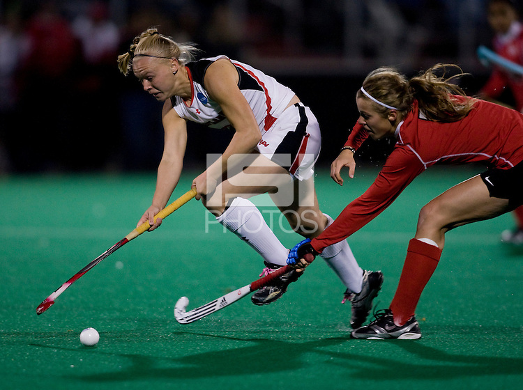Meghan Dean (8) of Maryland sprints past Nora Murer (7) of Ohio State during the NCAA Field Hockey Championship semfinals in College Park, MD.  Maryland defeated Ohio State, 3-1.