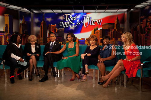 """United States President Barack Obama visits the set of """"The View"""" on ABC-TV in New York, New York on Monday, September 24, 2012. From left to right: Whoopi Goldberg, Barbara Walters, President Obama, First Lady Michelle Obama, Joy Behar, Sherri Shepherd and Elisabeth Hasselbeck..Credit: Allan Tannenbaum / Pool via CNP"""