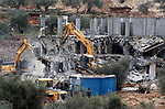 Israeli machineries demolish two under-construction Palestinian residential buildings in the West Bank town of Biet Jala, near Bethlehem January 29, 2018. Photo by Wisam Hashlamoun