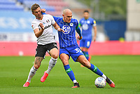 Wigan Athletic's Kal Naismith battles with Fulham's Joe Bryan<br /> <br /> Photographer Dave Howarth/CameraSport<br /> <br /> The EFL Sky Bet Championship - Wigan Athletic v Fulham - Wednesday July 22nd 2020 - DW Stadium - Wigan<br /> <br /> World Copyright © 2020 CameraSport. All rights reserved. 43 Linden Ave. Countesthorpe. Leicester. England. LE8 5PG - Tel: +44 (0) 116 277 4147 - admin@camerasport.com - www.camerasport.com
