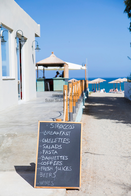 Siroccos Beach Bar and cafe on the beach just outside the city of Rethymno, Crete, Greece, Europe.  Sirocco Beach Cafe is owned by two young women who are also sisters - Kiki and Despoina Giamboudaki