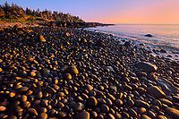 Sunset on a pebble beach at Flower's Cove