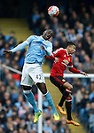 Yaya Toure of Manchester City tussles with Jesse Lingard of Manchester United during the Barclays Premier League match at The Etihad Stadium. Photo credit should read: Simon Bellis/Sportimage
