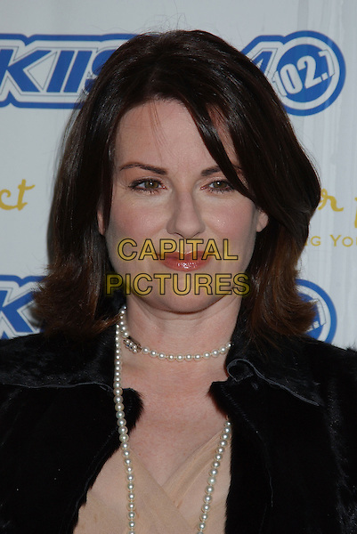 MEGAN MULLALLY.The Trevor Project's 'Cracked XMAS 7' held at the Wiltern LG..December 5th, 2004.headshot, portrait, pearl necklace.www.capitalpictures.com.sales@capitalpictures.com.© Capital Pictures.