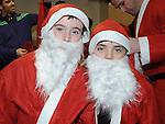 Matthew Askins and Tadhg Everitt Thompson who took part in the Santa Dash. Photo: Colin Bell/pressphotos.ie