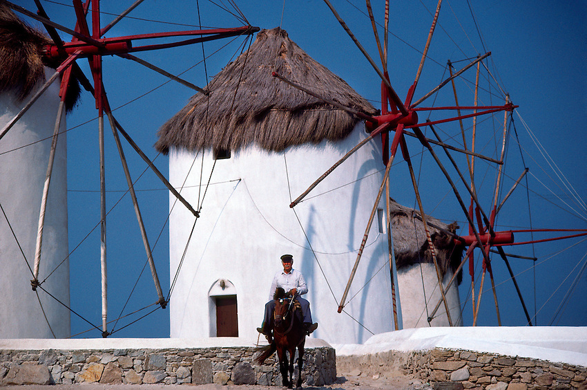 Man on horseback (windmills behind), Mykonos Town, Island of Mykonos, Greece