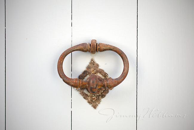 Old iron door knockers in Menerbes, France