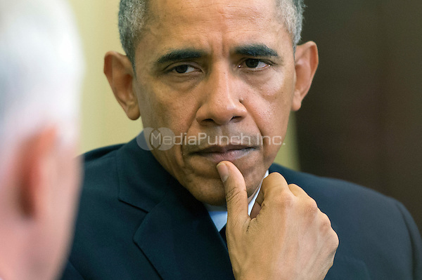United States President Barack Obama listens as Prime Minister Malcolm Turnbull of Australia speaks to the media prior to a meeting in the Oval Office at the White House on Washington, D.C. on January 19, 2016.<br /> Credit: Kevin Dietsch / Pool via CNP /MediaPunch