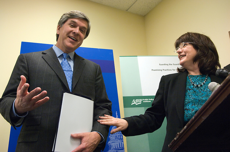 Gordon Smith, R-Ore., ranking member of the Senate (Special Committee on) Aging; and Susan Reinhard of the AARP joke during the .news conference to release the findings on elder abuse in the guardianship system..