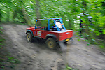 Land Rover Series based off-road racer competing at the ALRC National 2008 CCVT trial during very bad weather. The Association of Land Rover Clubs (ALRC) National Rallye is the biggest annual motor sport oriented Land Rover event and was hosted 2008 by the Midland Rover Owners Club at Eastnor Castle in Herefordshire, UK, 22 - 27 May 2008. --- No releases available. Automotive trademarks are the property of the trademark holder, authorization may be needed for some uses.