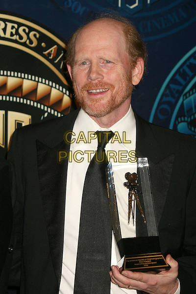 JOHN MEYER & RON HOWARD.American Society of Cinematographers 21st Annual Outstanding Achievement Awards at the Hyatt Regency Century Plaza Hotel - Press Room, Century City, California, USA..February 18th, .half length black jacket award trophy beard facial hair.CAP/ADM/BP.©Byron Purvis/AdMedia/Capital Pictures