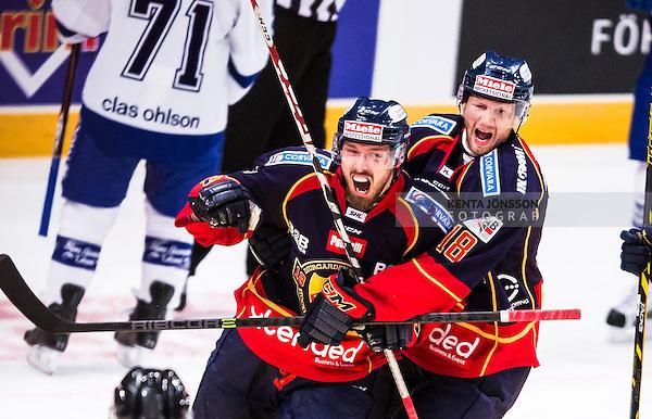 Stockholm 2014-09-17 Ishockey SHL Djurg&aring;rdens IF - Leksands IF :  <br /> Mikael Ahl&eacute;n jublar med Michael Holmqvist efter sitt 1-0 m&aring;l<br /> (Foto: Kenta J&ouml;nsson) Nyckelord:  Djurg&aring;rden DIF Hockey Globen Ericsson Globe Arena SHL Leksand LIF jubel gl&auml;dje lycka glad happy