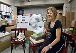 Yuko Kusano, co-founder of the NPO Miyagi-Jonet, sits in a storeroom filled with emergency and other supplies for women left homeless by the March disasters, in Sendai, Miyagi Prefecture, Japan on 09 Sept. 2011. Photograph: Robert Gilhooly
