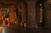 Kailash Temple at Ellora Caves Aurangabad, India.Kailash Temple, also Kailasa Temple is one of the 34 monasteries and temples, extending over more than 2†km, that were dug side by side in the wall of a high basalt cliff in the complex located at Ellora, Maharashtra, India. Of these 34 monasteries and temples, the Kailasa (cave 16) is a remarkable example of Indian rock-cut architecture on account of its striking proportion; elaborate workmanship architectural content and sculptural ornamentation.. It is designed to recall Mount Kailash, the abode of Lord Shiva[2]. While it exhibits typical Dravidian features, it was carved out of one single rock. It was built in the 8th century by the Rashtrakuta king Krishna I..The Kailash Temple is notable for its vertical excavation-carvers started at the top of the original rock, and excavated downward, exhuming the temple out of the existing rock. The traditional methods were rigidly followed by the master architect which could not have been achieved by excavating from the front. The architects found to design this temple were from the southern Pallava kingdom.. Cave 10 in Ajanta Caves contains the oldest Indian paintings of historical period, made around the 1st century BC.<br />
