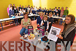 TEA TIME: Sheila Dennehy, Olga Slattery with Jennifer and Elizabeth Slattery and Aisling O'Brien enjoy the tea and cakes made by fifth and sixth classes in Caherleaheen National School who were holding a coffee morning in aid of Kerry Hospice on Thursday morning.