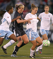 Allie Long (center) of the Washington Freedom pushes through between Ifeoma Dieke (4) and Ella Masar (3) of the Chicago Red Stars during a WPS match at Maryland Soccerplex on April 11 2009, in Boyd's, Maryland.  The game ended in a 1-1 tie.