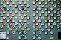 Dials in the Chernobyl First Block control room once showed the depth of each control rod in the reactor core. Just down the hall is the burnt-out Fourth Block control room, where a combination of design flaws and human error triggered the accident during a late-night safety test.  <br /> ------------------- <br /> This photograph is part of Michael Forster Rothbart's After Chernobyl documentary photography project.<br /> © Michael Forster Rothbart 2007-2010.<br /> www.afterchernobyl.com<br /> www.mfrphoto.com <br /> 607-267-4893 o 607-432-5984<br /> 5 Draper St, Oneonta, NY 13820<br /> 86 Three Mile Pond Rd, Vassalboro, ME 04989<br /> info@mfrphoto.com<br /> Photo by: Michael Forster Rothbart<br /> Date:  1/2009    File#:  Canon 5D digital camera frame 51336 <br /> ------------------- <br /> Original caption: .A wall of dials in the Chernobyl First Block control room once marked the depth of each control rod in the reactor core. Just down the hall is the burnt-out Fourth Block control room, where a combination of design flaws and human error triggered the accident during a late-night safety test. Most estimates say ninety-five percent of the radioactive materials remained on the grounds of the power plant or spread to the adjacent forest. Both were decontaminated, using the labor of about 850,000 liquidators from across the Soviet Union..-------------------.