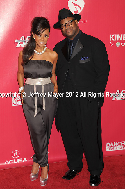 LOS ANGELES, CA - FEBRUARY 10: Jimmy Jam and Lisa Harris arrive at The 2012 MusiCares Person of The Year Gala Honoring Paul McCartney at Los Angeles Convention Center on February 10, 2012 in Los Angeles, California.