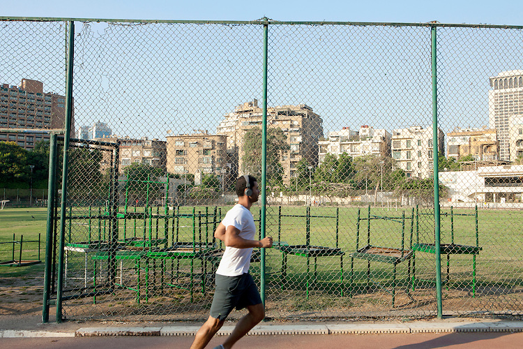 Egypt / Cairo / 29.7.2012 / Gezira Club, a young man goes jogging. Cairo. July 2012.<br />