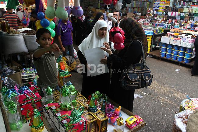 Palestinian women buy lanterns ahead of the Muslim holy fasting month of Ramadan at Al-Zawiya market in Gaza City on July 31, 2011. Photo by Ashraf Amra
