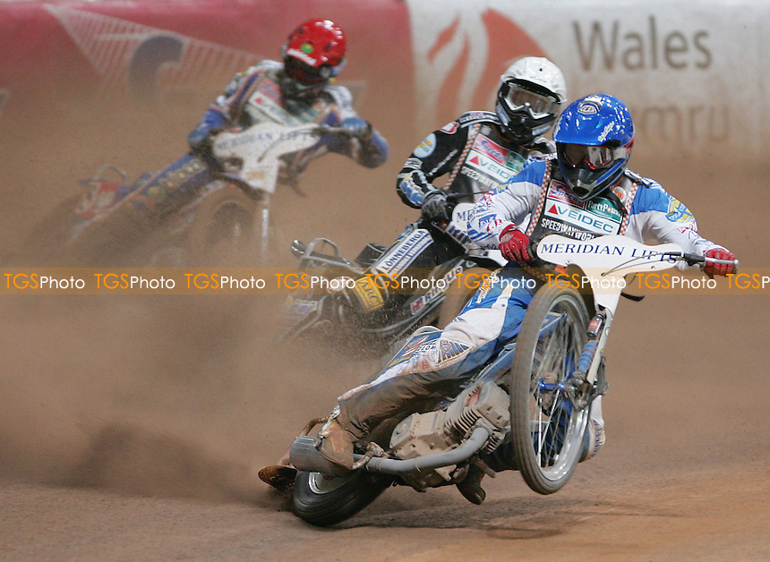 Heat 9 - Greg Hancock (Blue), Andreas Jonsson (White) and Tomasz Gollob (Red) - British Speedway Grand Prix at the Millenium Stadium, Cardiff - 30/06/07 - MANDATORY CREDIT: Rob Newell/TGSPHOTO