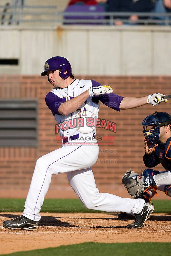 Devin Harris #34 of the East Carolina Pirates follows through on his swing versus the Virginia Cavaliers at Clark-LeClair Stadium on February 19, 2010 in Greenville, North Carolina.   Photo by Brian Westerholt / Four Seam Images