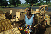 """Woman selling local craftmanship made of """"ronier"""" (Borassus aethiopum.mart) for household use"""