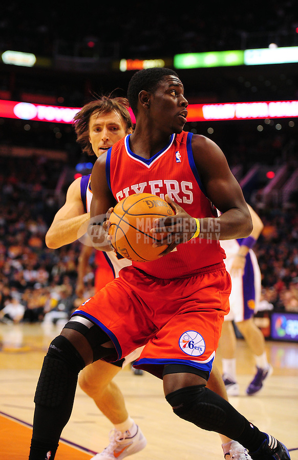 Dec. 28, 2011; Phoenix, AZ, USA; Philadelphia 76ers guard Jrue Holiday controls the ball during game against the Phoenix Suns at the US Airways Center. The 76ers defeated the Suns 103-83. Mandatory Credit: Mark J. Rebilas-USA TODAY Sports