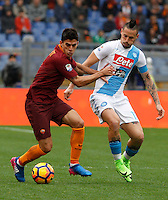 Roma&rsquo;s Diego Perotti, left, is challenged by Napoli&rsquo;s Marek Hamsik during the Italian Serie A football match between Roma and Napoli at Rome's Olympic stadium, 4 March 2017. <br /> UPDATE IMAGES PRESS/Riccardo De Luca