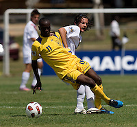 Keven Aleman (10) of Canda fouls Jabarry Chandler (11) of Barbados during the group stage of the CONCACAF Men's Under 17 Championship at Jarrett Park in Montego Bay, Jamaica. Costa Rica defeated El Salvador, 3-2.