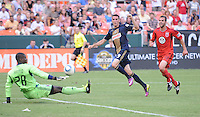Philadelphia Union midfielder Sebastien Le Toux (9) goes against DC United goalkepeer Bill Hamid (28) Philadelphia Union tied DC United 2-2, at RFK Stadium, Saturday July 2, 2011.