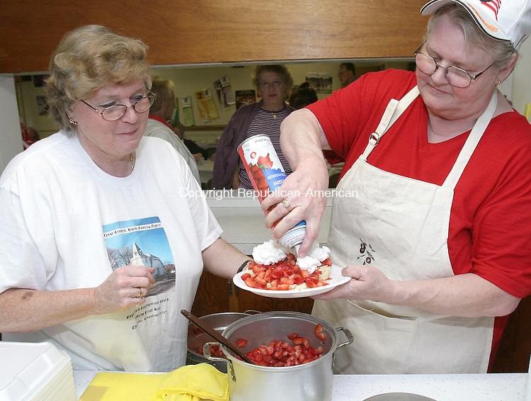 THOMASTON, CT -18 June 2005 -061805BZ01- Eagle Rock Congregational Church members Donna Sanford, of Thomaston, left, and Betty Torres, of Torrington, prepare a strawberry shortcake for Marilyn Atwoood, of Thomaston, (center-background) during the churches annual strawberry festival Saturday afternoon.  Sanford said she is the third generation of her family to make the biscuits.  They are still made with her grandmother's recipe, she said.  <br /> Jamison C. Bazinet Photo