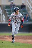 Javier Guerra (31) of the Greenville Drive hustles down the first base line against the Kannapolis Intimidators at CMC-Northeast Stadium on April 28, 2015 in Kannapolis, North Carolina.  The Intimidators defeated the drive 3-2.  (Brian Westerholt/Four Seam Images)