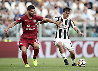 Calcio, Serie A: Torino, Allianz Stadium, 19 agosto 2017. <br /> Juventus' Paulo Dybala (r) in action with Cagliari's Marco Capuano (l) during the Italian Serie A football match between Juventus and Cagliari at Torino's Allianz Stadium, August 19, 2017.<br /> UPDATE IMAGES PRESS/Isabella Bonotto