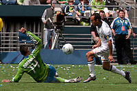 Tyrone Marshall of the Seattle Sounders goes for a sweep against Landon Donovan of the LA Galaxy at Quest Field on May 10, 2009. The Sounders and Galaxy played to a 1-1 draw.