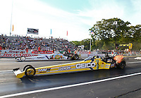 May 31, 2013; Englishtown, NJ, USA: NHRA top fuel dragster driver Morgan Lucas (near) races alongside Brandon Bernstein during qualifying for the Summer Nationals at Raceway Park. Mandatory Credit: Mark J. Rebilas-