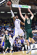 Baltimore, MD - Hofstra Pride guard Ameen Tanksley (2) goes by William & Mary Tribe forward Jack Whitman (41) for a ly up during the CAA Basketball Tournament at the Royal Farms Arena in Baltimore, Maryland on March 6, 2016.  (Photo by Philip Peters/Media Images International)