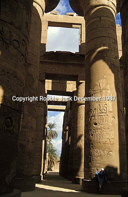 A guide beside the columns in the Great Hypostyle Hall in the Precinct of Amun.The hall covers 50,000 sq ft.The roof which has now fallen was supported by 134 columns in 16 rows, the 2 middle rows are higher than the others being 33 feet in circumference and 80 feet high.The hall was built by the Pharaoh Seti I who ruled Egypt from 1290 or 1294 BC -1279 BC and was completed by his son the Pharaoh Ramesses II who ruled from 1279-1213 BC.  Karnak is part of the ancient city of Thebes ( built in and around modern day Luxor).The building of the Temple complex at Karnak began in the reign of the Pharaoh Senusret I who ruled Egypt from 1971 -1926 BC. Approximately 30 Pharaohs contributed to the building of the complex and in so doing made it the largest ancient religious site in the world. The ancient name for Karnak is Ipet-isut (Most select of places).